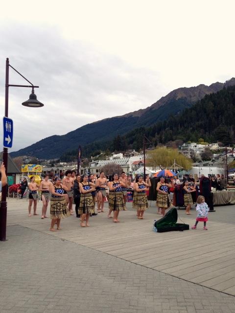 school of young dancers performing maori dances in queenstown