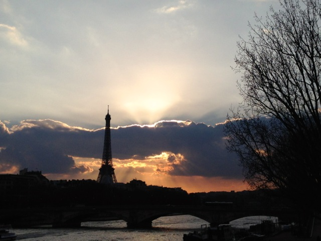 eiffel tower and the seine at sunset