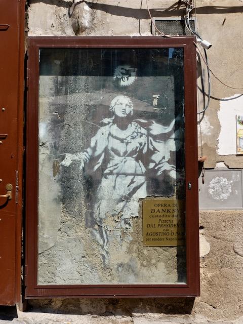 Banksy graffiti art madonna with a pistol